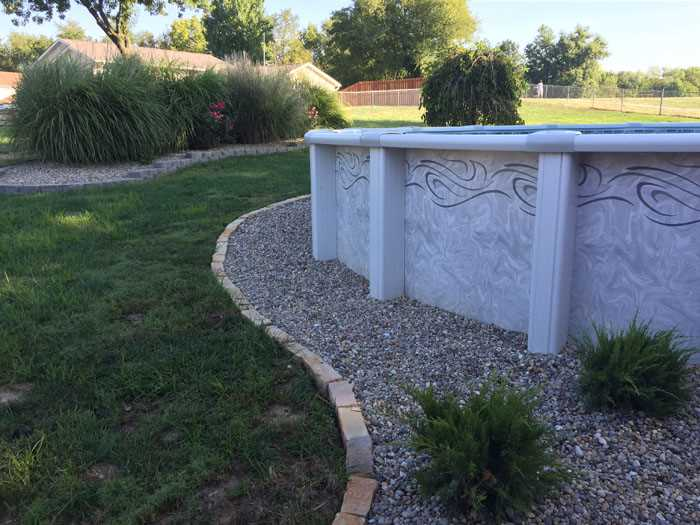 Landscaping around above-ground pool - Tri-County Hardscape Group